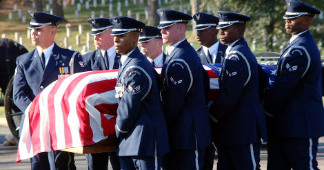 """001117-F-7466S-026Members of the U.S. Air Force Honor Guard carry the casket of U.S. Air Force Medal of Honor recipient John L. Levitow to his grave in Arlington National Cemetery where he will be buried with full military honors on Nov. 17, 2000.  Levitow earned the medal as an airman 1st class serving as loadmaster aboard a severely damaged AC-47 gunship flying a mission over Long Binh, South Vietnam, on Feb. 24, 1969.  A C-17 Globemaster III was named """"The Spirit of John L. Levitow,"""" in his honor Jan. 23, 1998.  Levitow died at his home in Connecticut on Nov. 8, 2000, after a lengthy battle with cancer.  DoD photo by Tech. Sgt. Mark A. Suban, U.S. Air Force.  (Released)"""